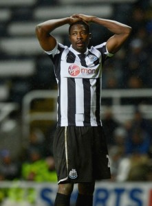 shola ameobi hands on head
