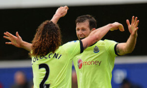 Newcastle United's Fabricio Coloccini and Mike Williamson celebrate after the 2-1 win at QPR
