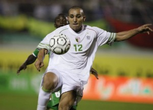 Algeria's Djebbour fights for the ball with Zambia's Mbola during their World Cup 2010 qualifying soccer match in Blida