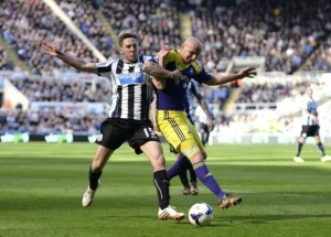 Swansea City's Shelvey challenges Newcastle United's Gosling during their English Premier League soccer match in Newcastle
