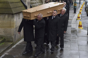 sweeney casket being acrries in
