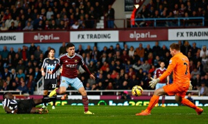 West Ham's Aaron Cresswell scores past Newcastle goalkeeper Robert Elliot in the Premier League