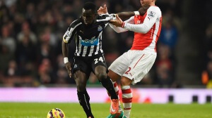 during the Barclays Premier League match between Arsenal and Newcastle United at Emirates Stadium on December 13, 2014 in London, England.