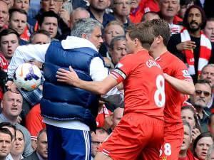 jose mourinho holds ball