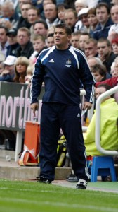 john carver on sideline in blue