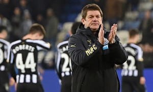 The Newcastle caretaker head coach, John Carver, applauds the away fans