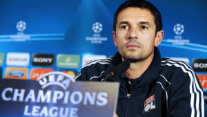 Lyon's coach Remi Garde gives a press co