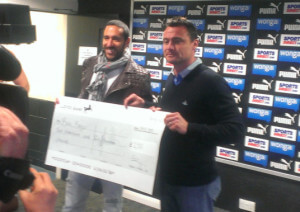 Steve Harper presents a cheque to Jonas Gutierrez.
