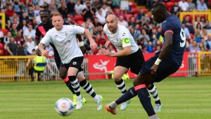 GATESHEAD, ENGLAND - JULY 10 : Papiss Cisse of Newcastle scores from the penalty spot in the first half during the pre season friendly between Gateshead and Newcastle United at Gateshead International Stadium on July 10, 2015 in Gateshead, England.  (Photo by Mark Runnacles/Getty Images)
