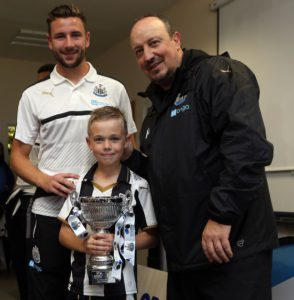 paul dummett and rafa benitez with young star