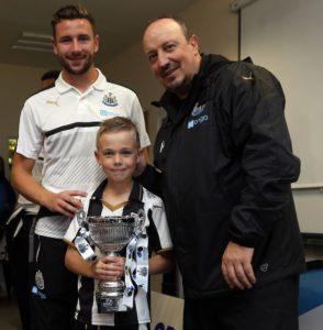 paul dummett and rafa benitez with young star