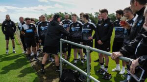 rafa benitez with Academy youngsters