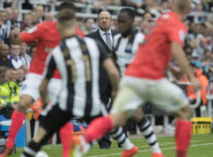rafa benitez in background newcastle vs brighton