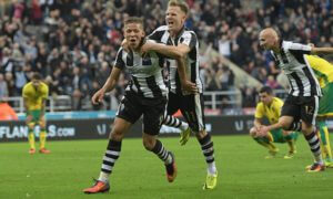 Dwight Gayle of Newcastle United (left) celebrates scoring their fourth goal during the Sky Bet Championship match between Newcastle United and Norwich City played at St. James' Park, Newcastle on 28th September 2016